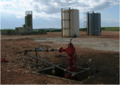Wellhead left after fracking equipment has been removed. Photo credit: Joshua Doubek